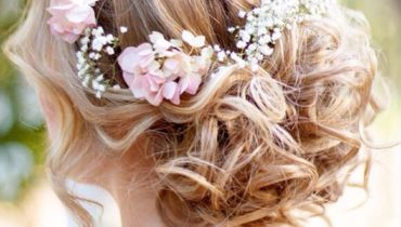 Messy Bun Decorated With Pink Flowers