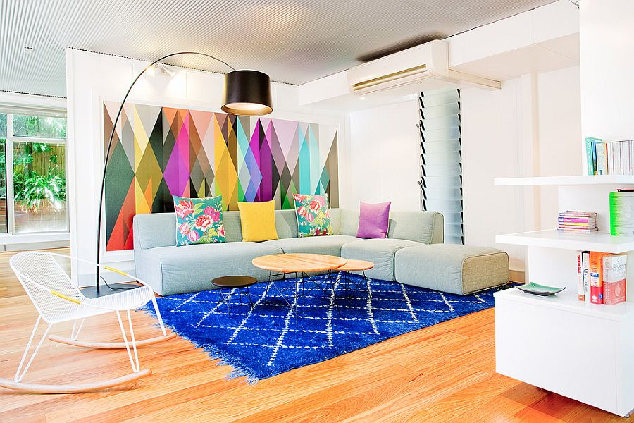 Brilliant living room with creative use of colorful wallpaper and rug Design - Touch Interiors