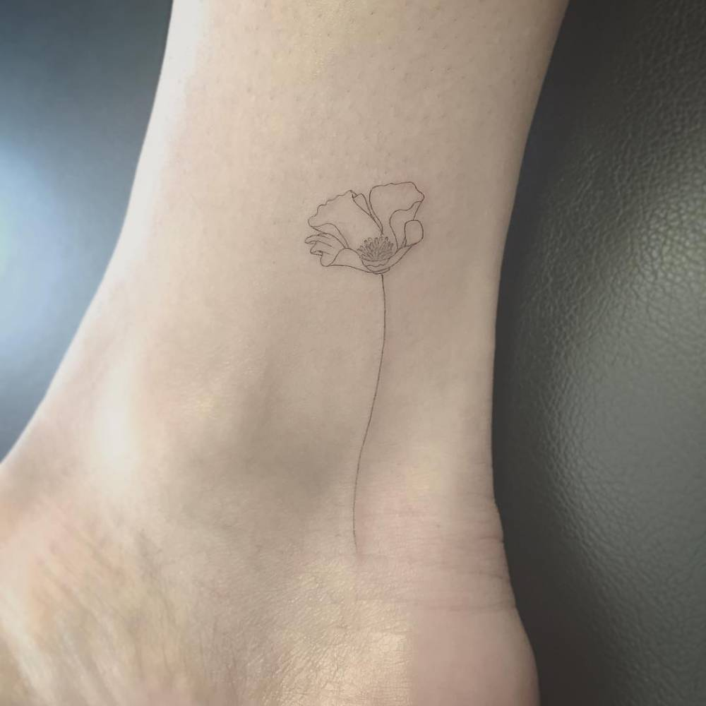 Fine line style poppy on the ankle